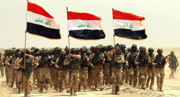 Soldats irakiens prennent part à un exercice de formation mené par l'armée américaine près de Bagdad, le 27 mai 2015